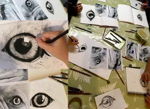 children's drawings of animal eyes in charcoal and pencil
